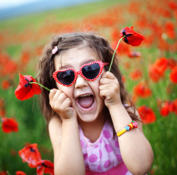 bigstock-Cute-child-girl-in-poppy-field-12140882