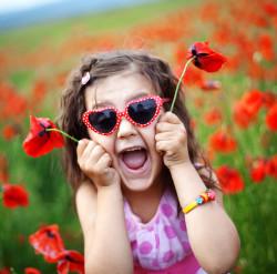 bigstock-Cute-child-girl-in-poppy-field-12140882